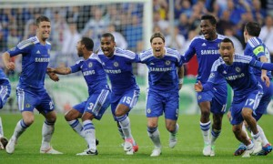 The Chelsea players celebrate as Drogba scores final penalty